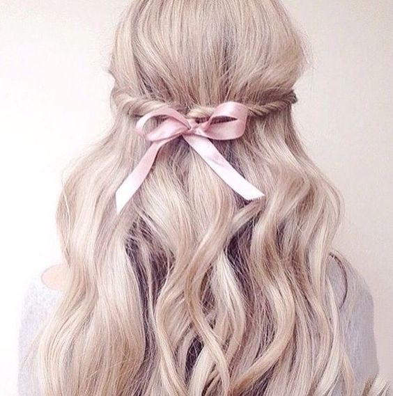 Cute pink bow on hairs.