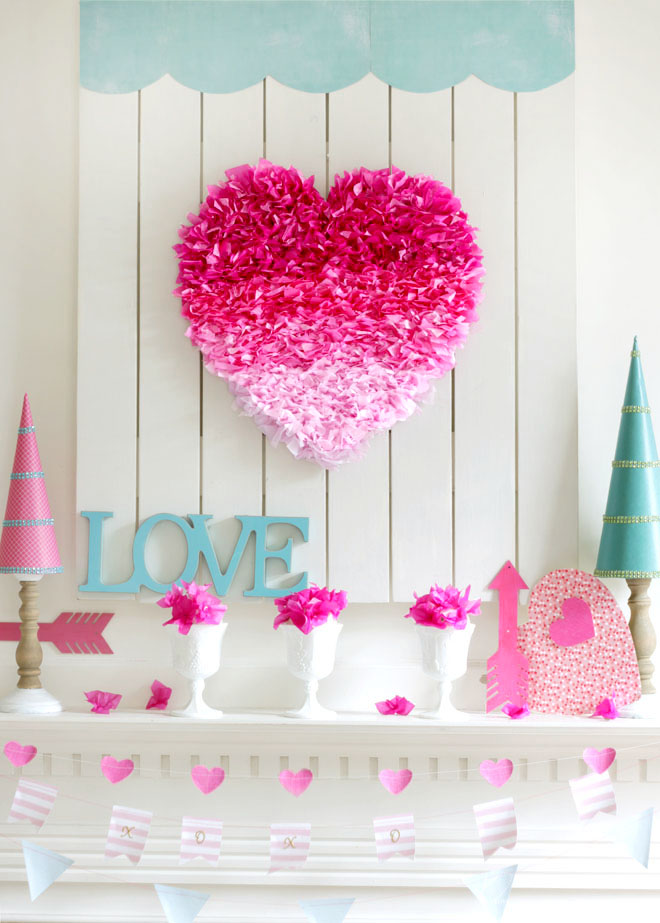 DIY pink tissue heart with aque blue accents for Valentine mentel decoration.