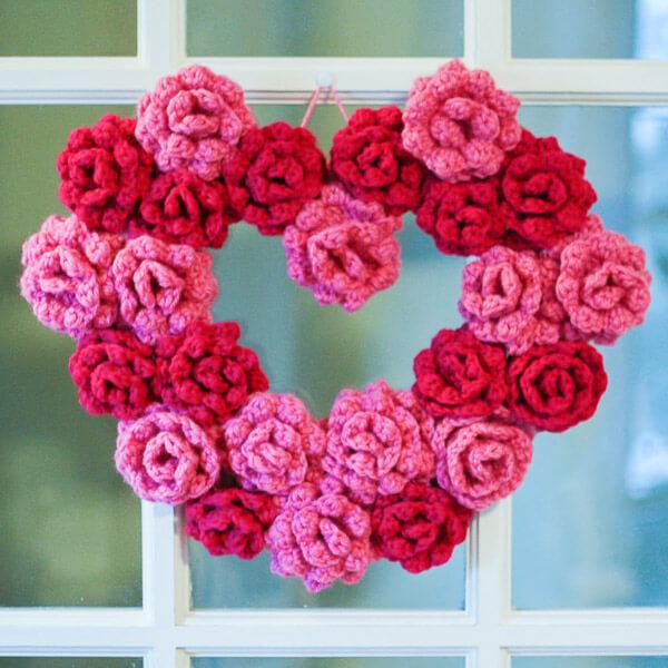Dark and light pink crochet heart wreath.