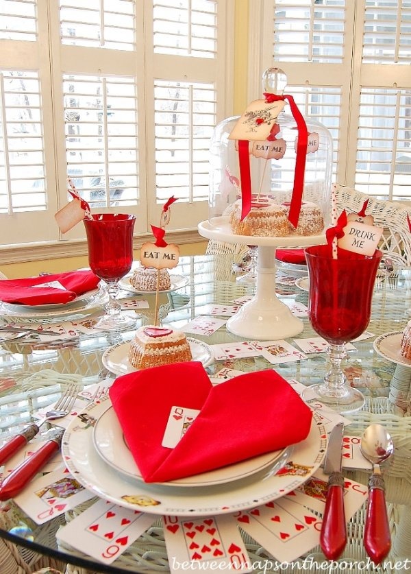Dashing Valentines day table setting with heart napkin folding.