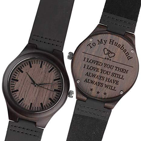 Engraved wooden wrist watch.