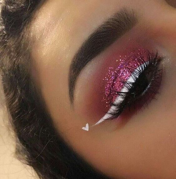 Fabulous glitter makeup with white eye linear and heart.