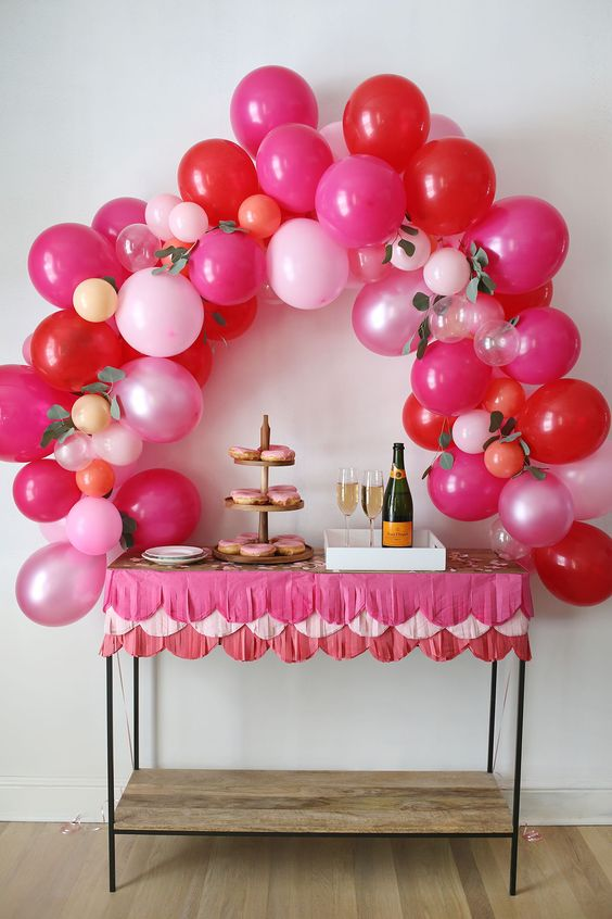 Fancy pink balloon arch for romantic party decoration.