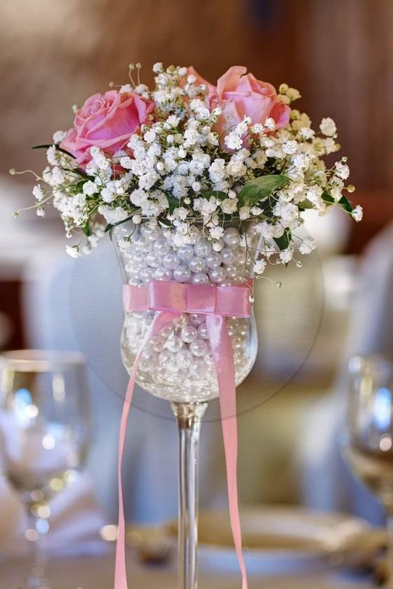 Flower vase filled with pearls.