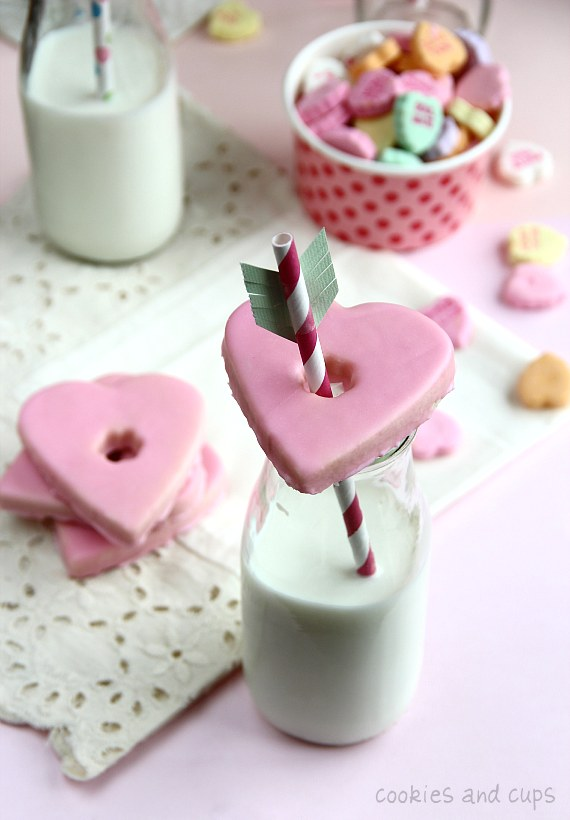 Glass topped heart shaped cookies with milk.