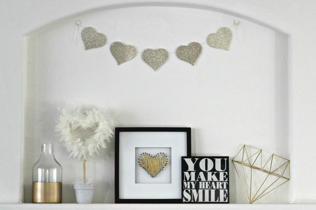 Gold & white glitter mantel decor for Valentine's day.
