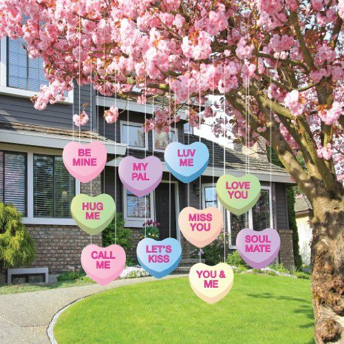 Hanging candy hearts for lawn decoration.