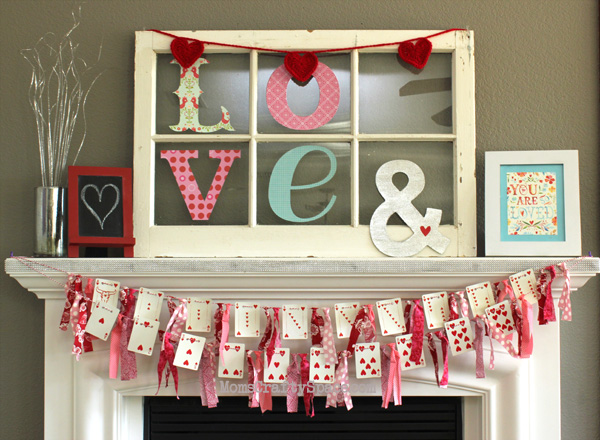 Heart garland with LOVE letter on mantel look amazing.