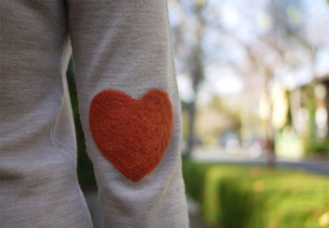Heart patch sweater on elbow.