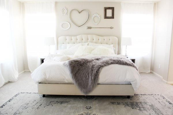 Ivory and fur bedroom with love sign wall decor.