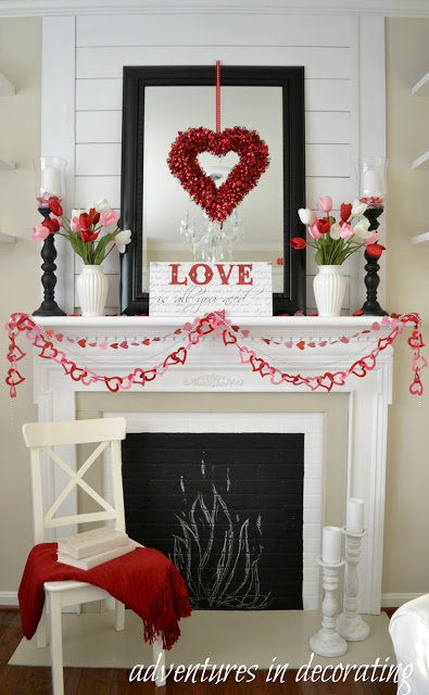 Lovely wreath, heart cutout garland and love sign board are perfect for Valentine's day mantel decor.