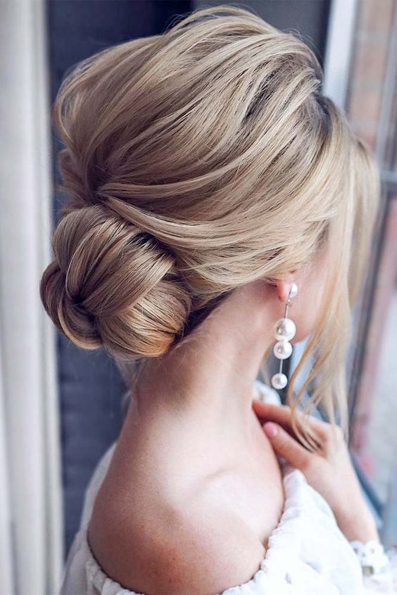 Low hair bun perfect for special day.
