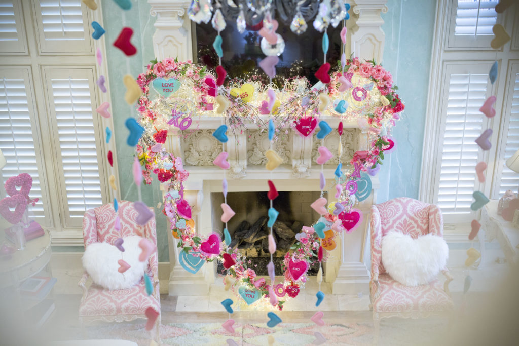 Mantel decoration with heart garland.