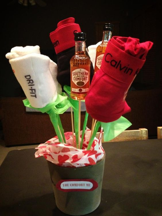 Masculine bouquet with rose boxers, mini Soco bottles etc.