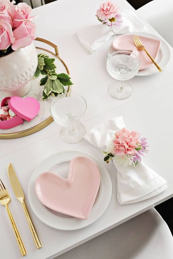 Modish valentine day table setting with floral napkin ring.