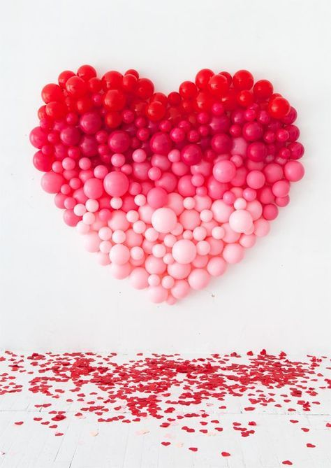 Ombre heart balloon backdrop perfect for Valentines day party.