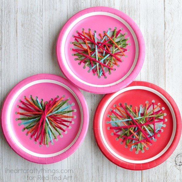 Paper plate yarn heart craft.