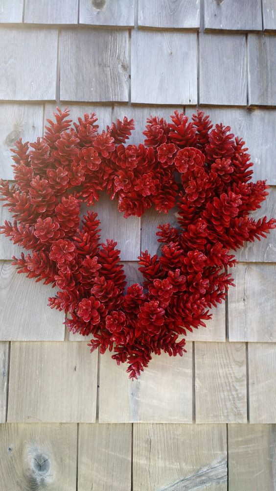 Pinecone wreath in heart shape for valentine day.