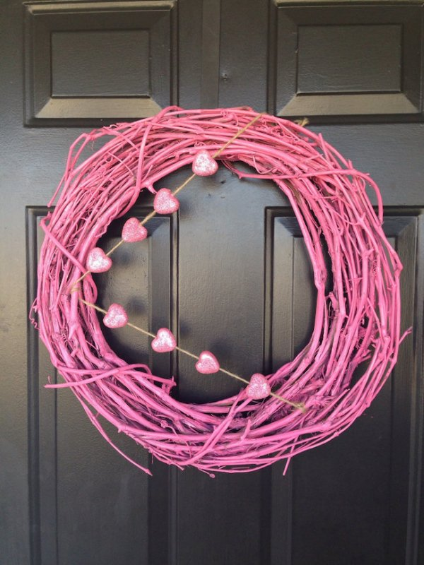 Pink grapvine wreath with hearts.