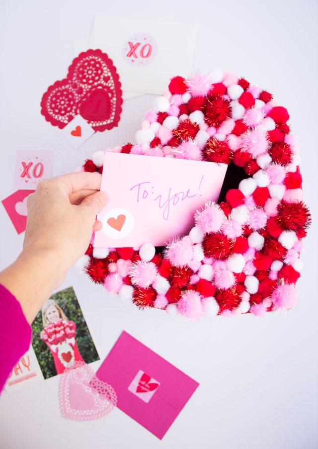 Pom pom card holder for Valentines day.