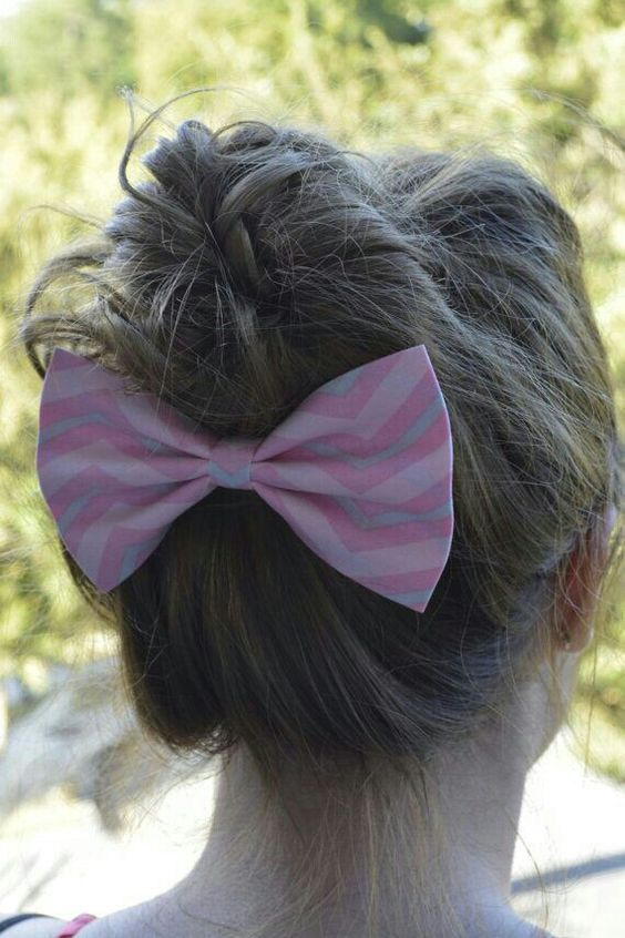 Pretty pink striped bow on upside down bun.