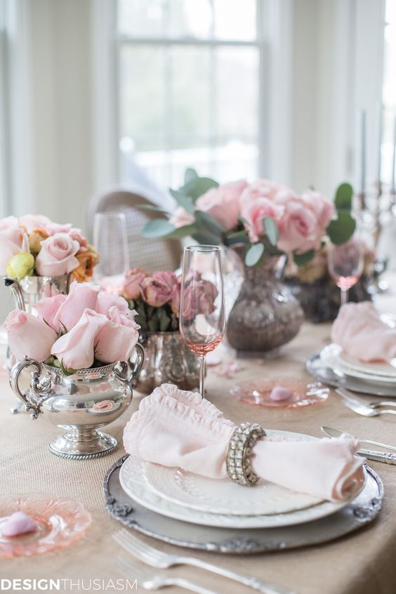 Pretty pink theme table setting for special day.