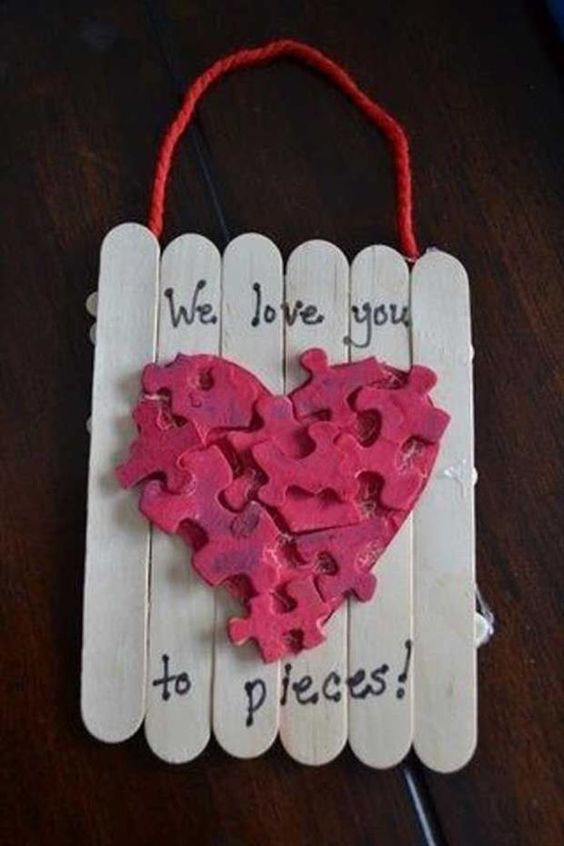 Puzzle piece popsicle sticks Valentines day craft.
