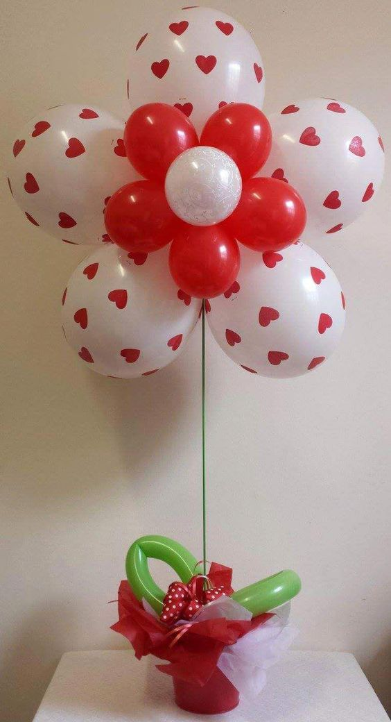 Red and white balloons designed as flower.