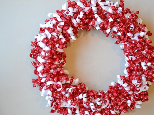 Red and white curled grosgrain ribbon wreath.
