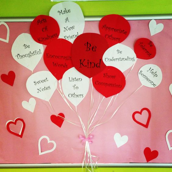 Red and white paper balloons on bulletin board.
