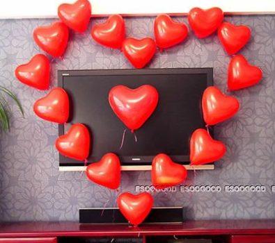 Red heart balloons in heart shape.