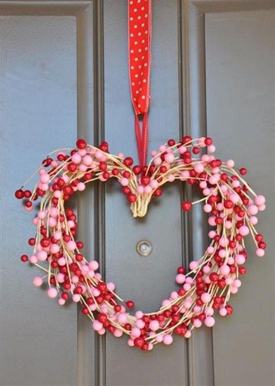 Red & pink beaded wreath in heart shape.
