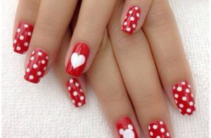 Red polka dots nails with heart.