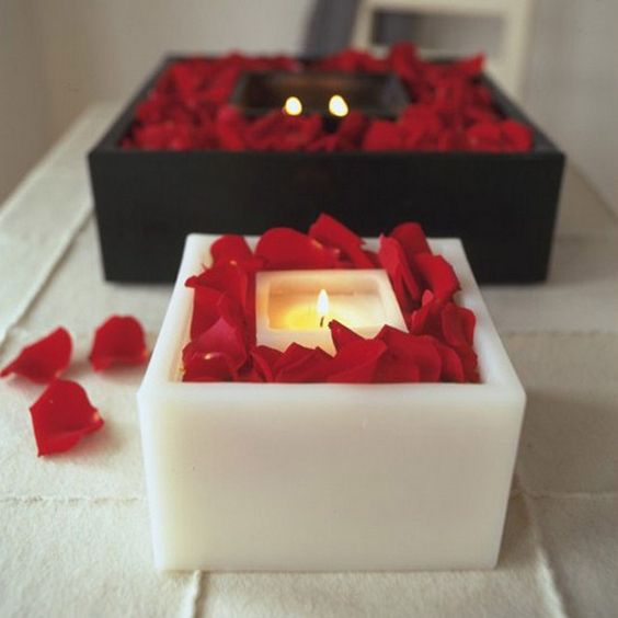 Red rose petals candles for special day.