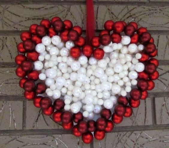 Red & white balls in heart shape for wreath.