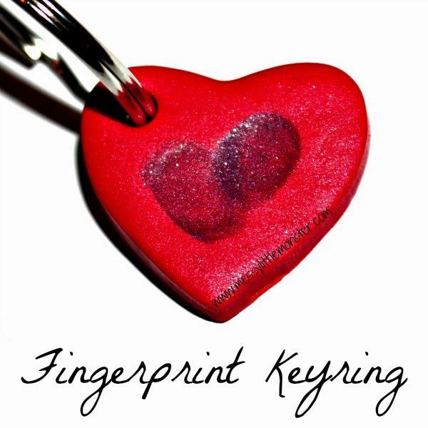 Rocking finger print heart key ring.
