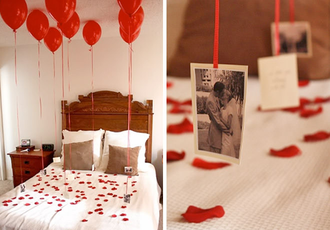 Romantic bedroom decoration with love petals and hanging photos.