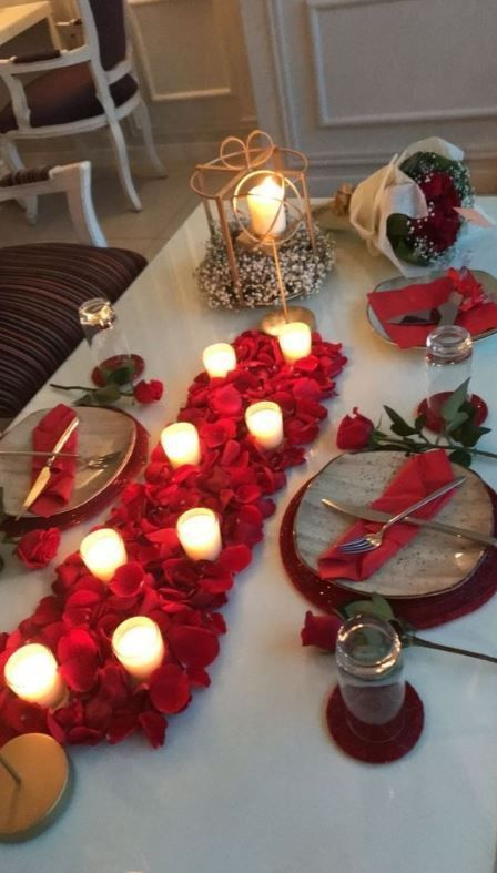 Romantic candle light dinner with beautiful roses.