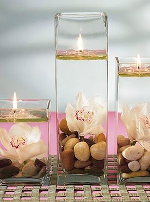Romantic candles with stones and flowers.