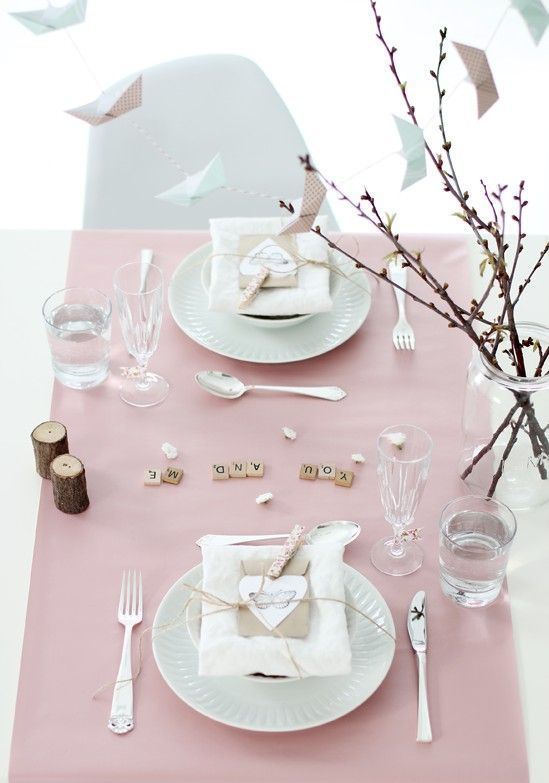 Romantic pale pink Valentine's day table setting.
