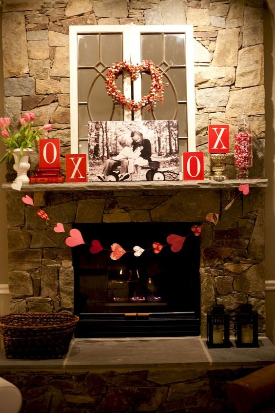 Rustic mantel decor with heart wreath, garland, photo and XOXO.