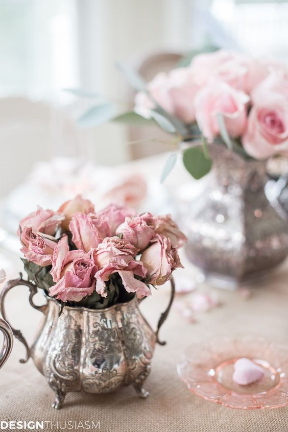 Shabby chic pink flower decor at table.