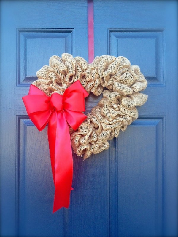 Simple heart shape burlap wreath with pink bow.