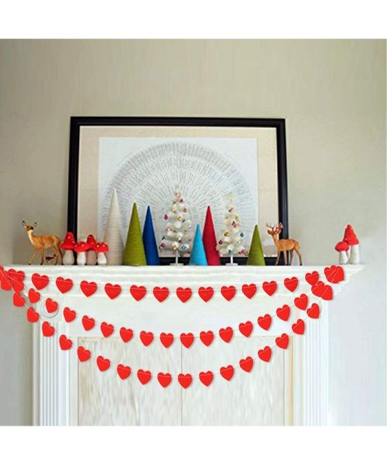 Simple mantel decor with heart banner.