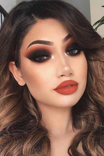 Smokey eyes with matte red lips.
