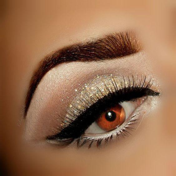 Stunning gold shimmer eye makeup.
