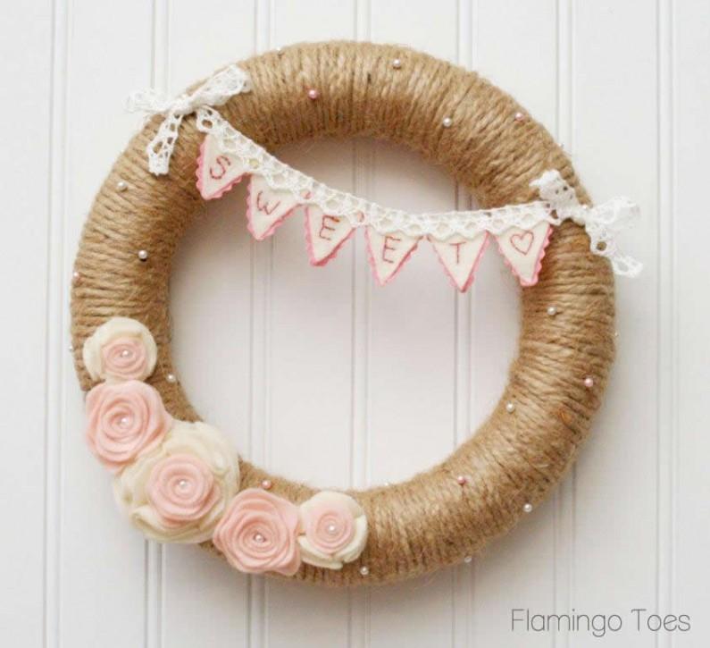 Sweet burlap wreath with pink flowers.
