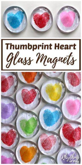 Thumb print heart glass magnet.