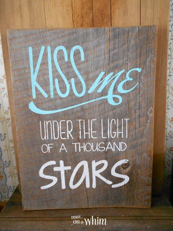 Under the light of a thousand stars wooden sign board.