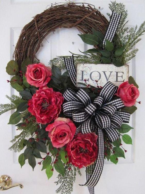 Valentines door hanger decorated with fresh flowers.